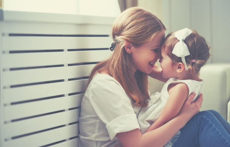 Happy loving family. mother and child playing,  kissing and hugging